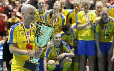 Sweden's Anna Wijk lifts the winner trophy after winning against Switzerland, after the 12th Women's World Floorball Championships between Sweden vs Switzerland, in Neuchatel, Switzerland, Sunday, Dec. 15, 2019.  Sweden won the game during the overtime period of the Gold Medal game. (Salvatore Di Nolfi/Keystone via AP)  LRC820