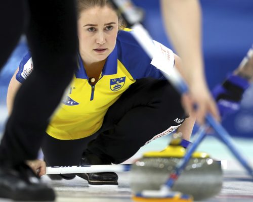 Sweden's Sara McManus watches as her teammates sweep a path for the stone during their match against Scotland in the CPT World Women's Curling Championship 2017 in Beijing, China, Saturday, March 25, 2017. (AP Photo/Mark Schiefelbein)