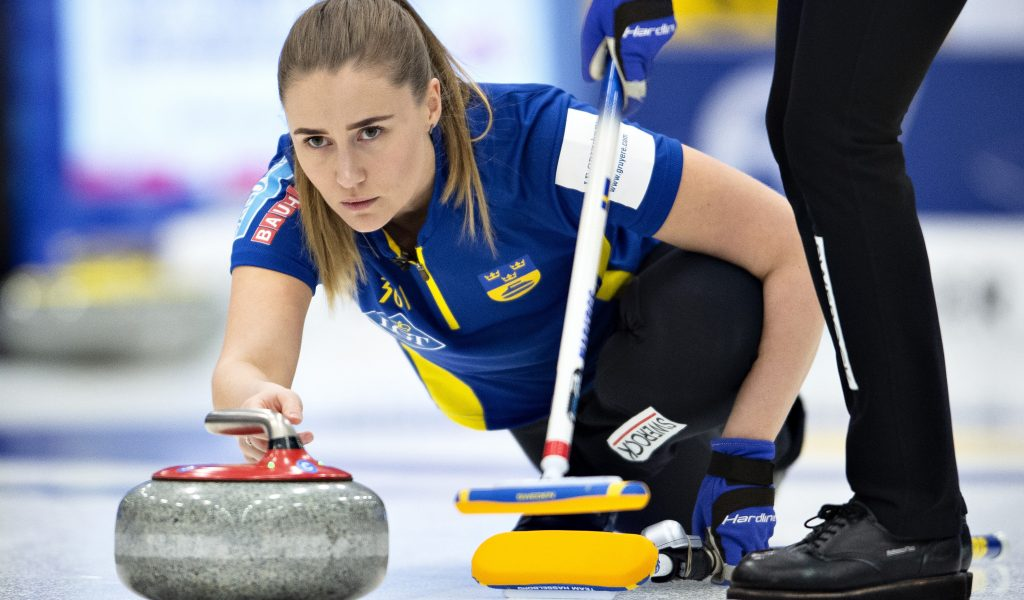 Sweden's Sara McManus in action during the final match between Sweden and Switzerland at the Women's Curling World Championship in Silkeborg, Denmark, Sunday March 24, 2019. (Henning Bagger/Ritzau Scanpix via AP)